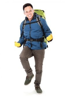 Male hiker with backpack raised his arm