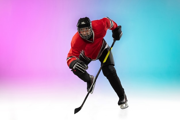 Male hockey player with the stick on ice court and neon gradient space