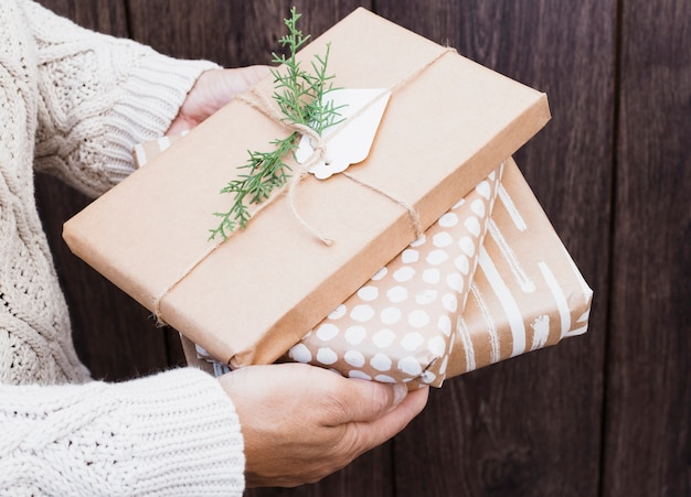 Male holding present boxes