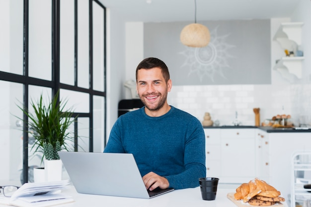 Male at home using laptop mock-up