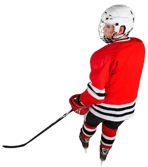 Male ice hockey player in helmet holding hockey stick on a white background
