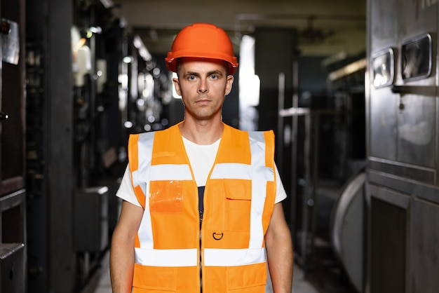 Male inspection person in protective hardhat wear engineer planning manufacture work blueprint