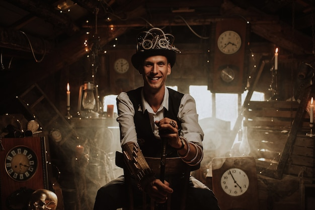 Male inventor in a steampunk suit with a hat, glasses and a cane smiles