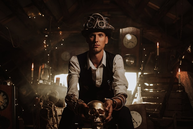 Male inventor in a steampunk suit with a hat, a top hat with glasses and mechanisms