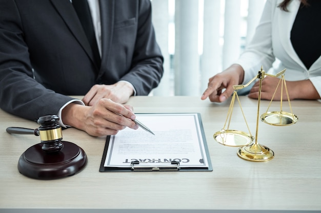 Male lawyer or counselor discussing negotiation legal case with client meeting with document contract in office, law and justice, attorney, lawsuit concept.