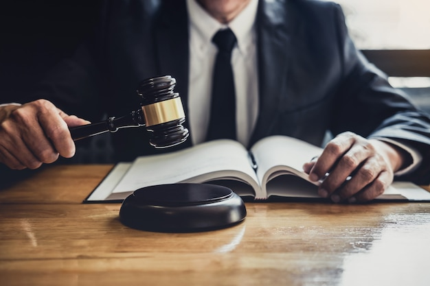 Male lawyer or judge working with contract papers