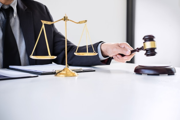 Male lawyer or judge working with law books, gavel, report the case