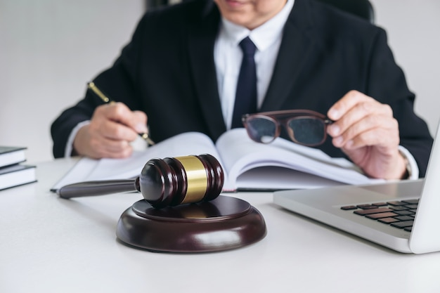 Male lawyer or judge working with law books