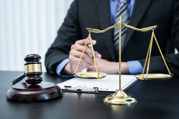 Male lawyer working with legal case document contract in office.