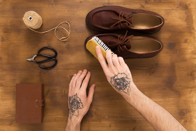 Male leather shoes on wooden background