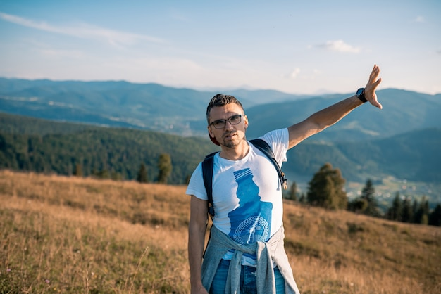 Male man traveler on the background of the mountains