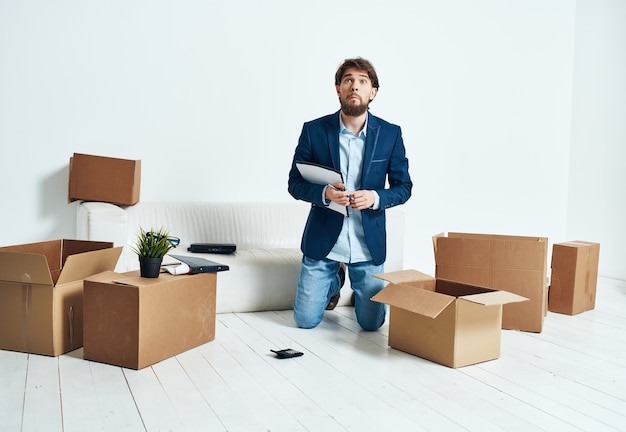 Male manager unpacking boxes office moving