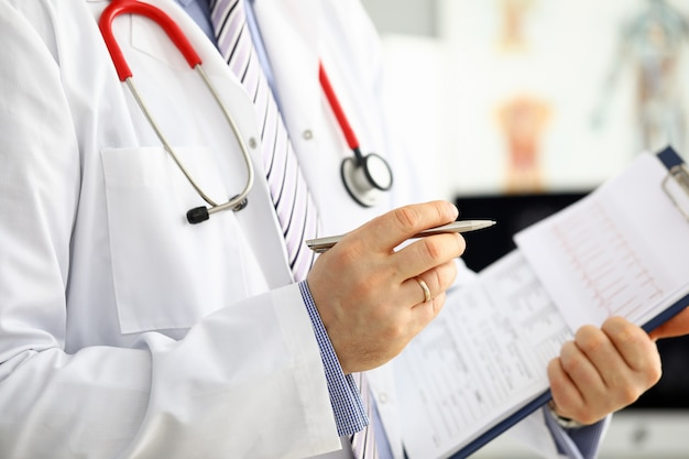 Male medicine doctor hand holding silver pen