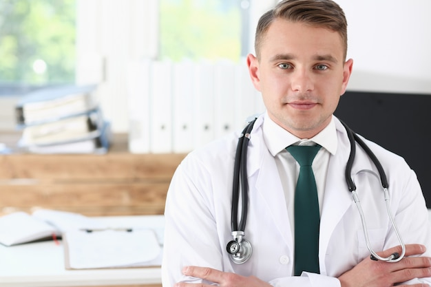Male medicine doctor his chest in office
