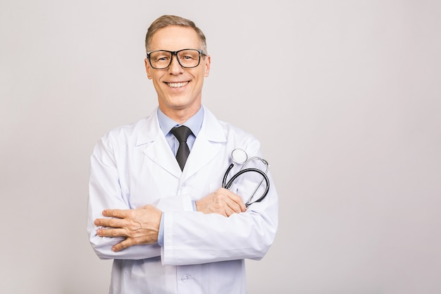 Male medicine therapeutist doctor hands crossed on his chest holding stethoscope closeup isolated on grey wall. medical help or insurance concept.