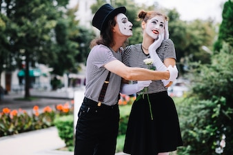 Kiss vectors photos and psd files free download male mime embracing happy female mime in park altavistaventures Gallery