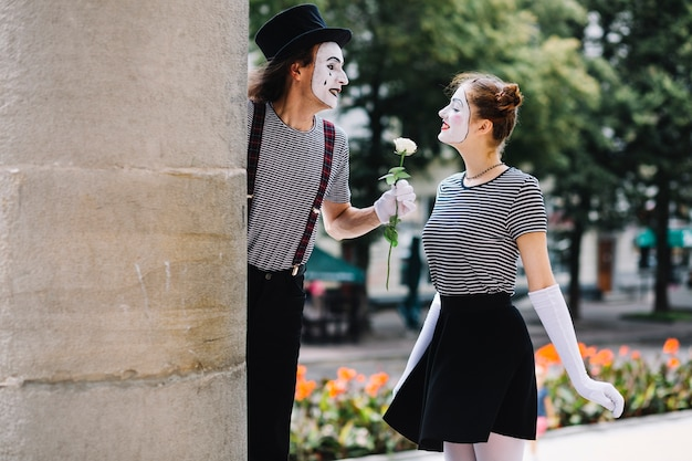 Male mime giving flower to female mime