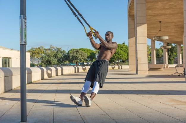 Male muscular training with system trx