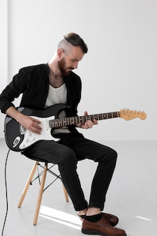 Male musician playing electric guitar