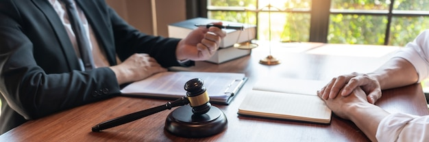 Male notary lawyer or judge consult or discussing contract papers