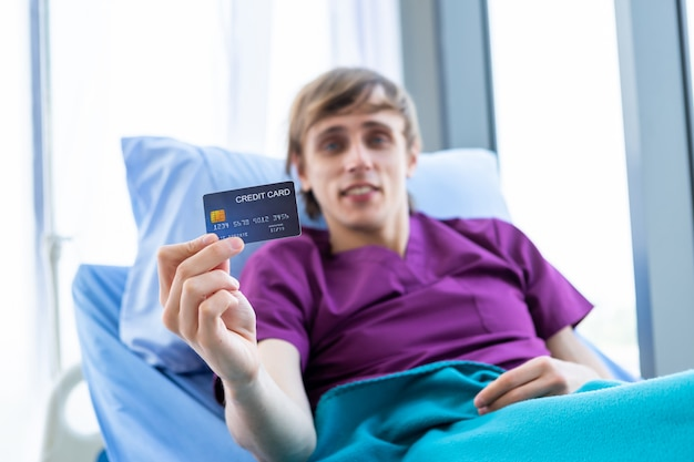 Male patient showing a credit card
