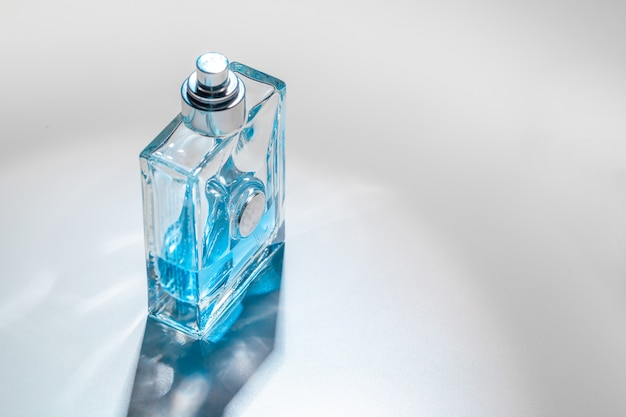 Male perfume bottle with reflections.