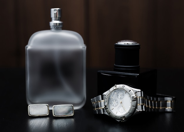 Male perfume and watches on a wooden. men's accessories