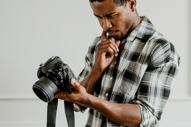 Male photographer holding a camera