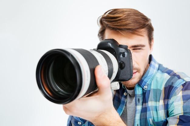 Male photographer making shot on photo camera