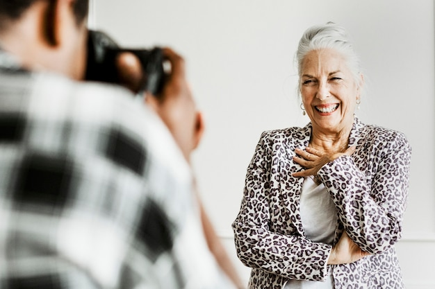 Male photographer and senior female client