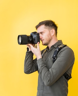 Male photographer taking picture with camera