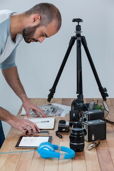 Male photographer working at desk