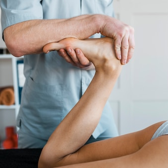 Male physiotherapist and female patient during a massage session