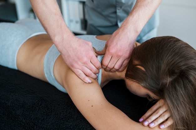 Male physiotherapist and woman during a physical therapy session