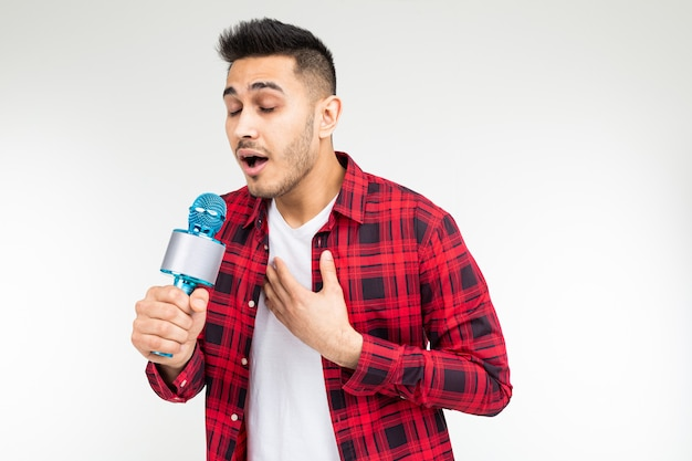 Male presenter with a microphone in his hands has a sore throat on a white isolated studio background