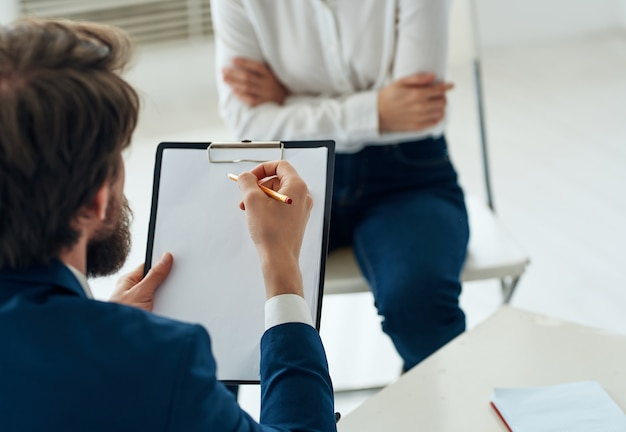 Male psychologist next to woman patient therapy consultation treatment