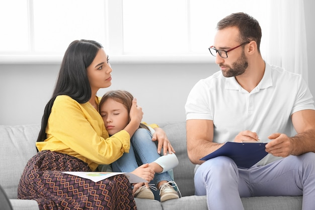 Male psychologist working with family at home
