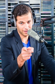 Male radio presenter in radio station on air