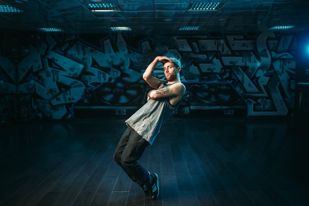 Male rapper in dance studio, rap performer. modern urban dancing style