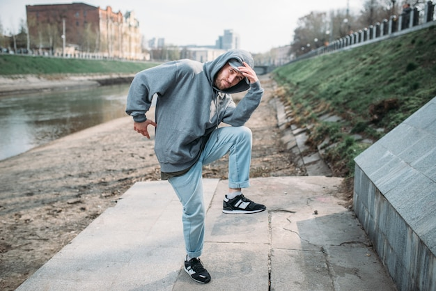 Male rapper posing on the street, urban dancing