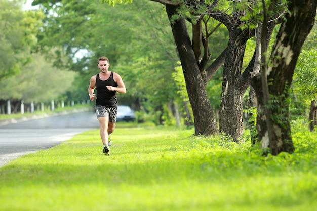 Male runner training for marathon at the park