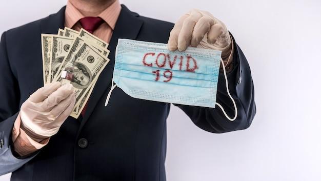 Male's hands in medical gloves give 100 dollar bills for medical masks. quarantine, for protection against ncovid19