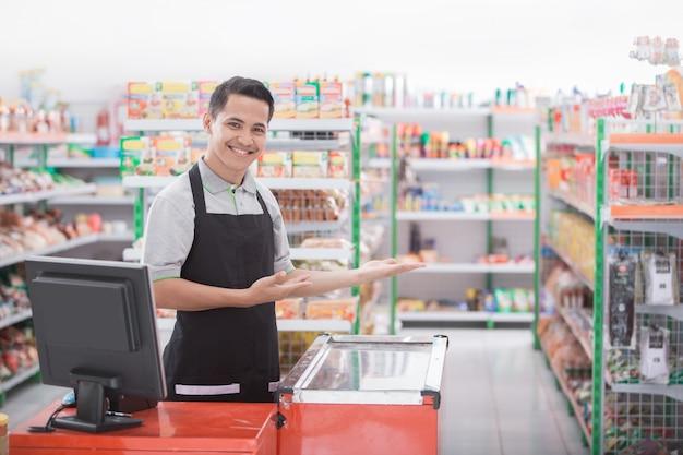 Male shopkeeper welcoming customer