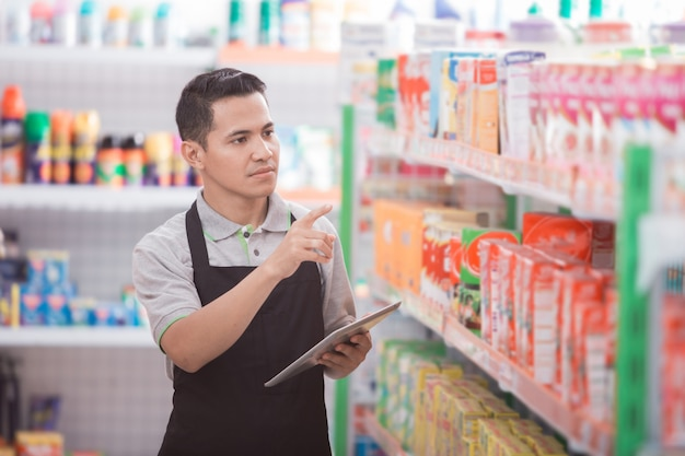 Male shopkeeper working in a grocery store