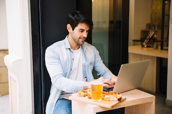 Male sitting in cafe with laptop
