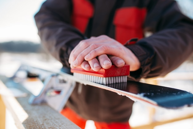 Male skier hands prepares skis for riding. winter active sport, extreme lifestyle. downhill skiing