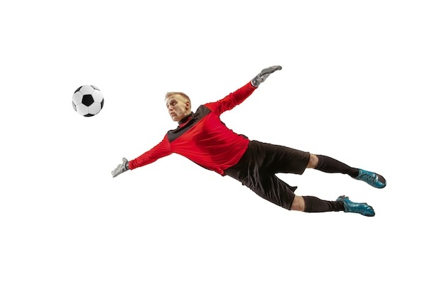 Вратарь мужского футболиста ловит мяч в прыжке. силуэт подходящего человека с мячом, изолированные на белом фоне студии