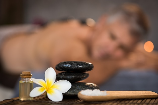 Male spa setting with black hot stones