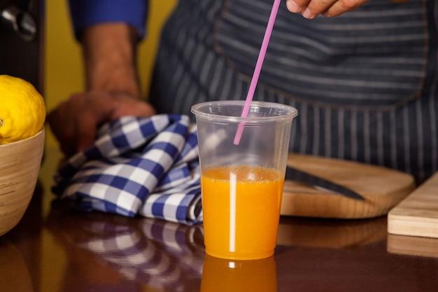 Male staff putting straw in a glass