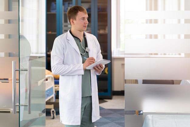 Male student practicing medicine